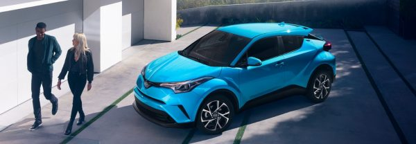 2 people walk away from their parked 2019 Toyota C-HR