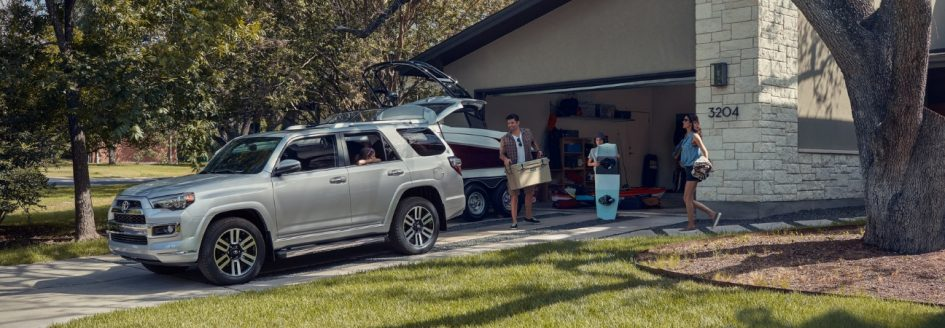 Silver 2019 Toyota 4Runner being loaded by a family going on vacation.
